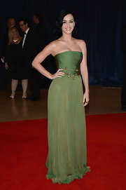Katy Perry chose this flowing green gown with a gold sheen and gold bauble detailing for her red carpet look at the White House Correspondents' Association Dinner.