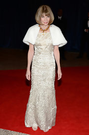 Anna Wintour looked sleek and elegant as ever when she wore this cream column-style gown.