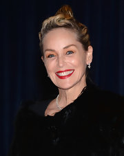 Sharon Stone's vibrant red lips added a touch of old-Hollywood glamour to her red carpet look.