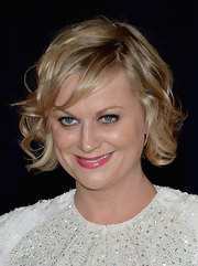 Amy Poehler styled her short blonde crop into loose curls for an elegant and dressy red carpet 'do.