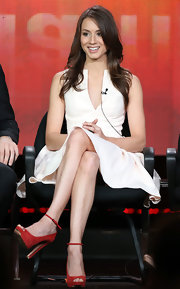 Troian Bellisario was minimalist chic in a white dress with a geometric neckline during the 2013 Winter TCA Tour.