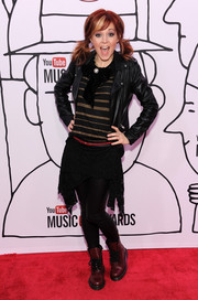 Lindsey Stirling added color (and some more edginess) with a pair of red lace-up boots.
