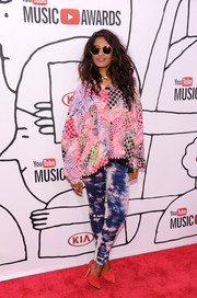 M.I.A. attended the YouTube Music Awards wearing what looked like a poncho with a busy print.