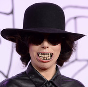 Lady Gaga hit the YouTube Music Awards wearing a Dior Homme bowler hat and some grotesque dentures!