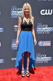 Tara went for a color-blocked look with this black and blue ruffled fishtail dress.