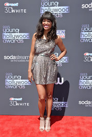 Aisha glistened in a silver sparkly mini dress, which she sported at the 2013 Young Hollywood Awards.