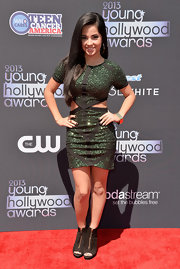 Becky G's deep emerald green frock with triangular cutouts showed just enough skin without being too revealing.