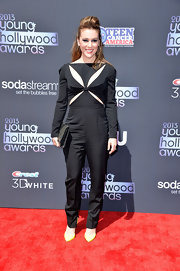 Alyssa's futuristic jumpsuit featured cool cutout details on the bodice and high-waist tapered pants.