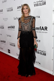 Ana Beatriz Barros chose the most perfectly feminine gown, featuring a sheer bodice and a tiered skirt, for the amfAR Inspiration Gala.