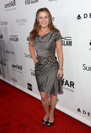 Alison Sweeney opted for a gray cocktail dress with a cowl neck and waist embellishments when she attended the amfAR Inspiration Gala.
