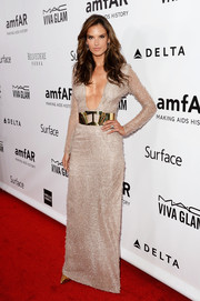 Alessandra Ambrosio put on a major show of cleavage in a silver Hugo Boss dress with a navel-skimming neckline during the amfAR Inspiration Gala.