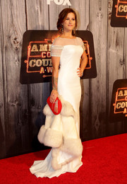 Cassadee Pope looked exquisite in a white sheer-yoke gown with embellished sleeves, which she styled with a fur coat, during the American Country Countdown Awards.