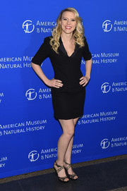 Kate McKinnon styled her dress with a pair of black lace strappy sandals.