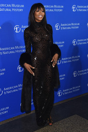 Naomi Campbell looked seductive in a slinky, paillette-embellished black gown by Roberto Cavalli during the American Museum of Natural History Gala.