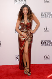 Jordin Sparks flaunted cleavage, legs, and curves in a fully sequined gold gown by Halston Heritage during the American Music Awards.