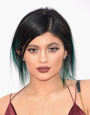 Kylie Jenner looked like a mannequin with her mile-long lashes and impossibly plump pout.