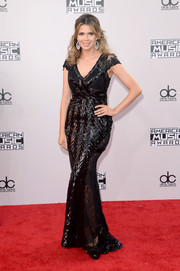 Carly Steel shone on the American Music Awards red carpet in a sequined black gown by Cristallini.