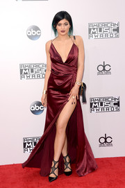 Kylie Jenner completed her fiercely sexy red carpet look with black mesh-strap pumps by Tamara Mellon.
