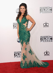 Danica McKellar was prom queen during the American Music Awards in an embroidered green and nude gown by Mac Duggal.