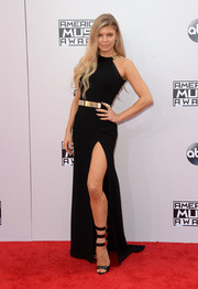 Fergie was edgy-glam at the American Music Awards in a black Halston Heritage gown with a thigh-baring slit and gold accents along the neckline and waist.