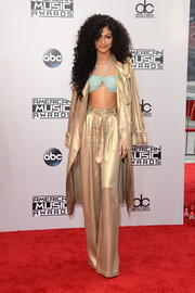 Zendaya Coleman did matchy-matchy the funky way with this Georgine trenchcoat and wide-leg pants combo.