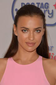 Irina Shayk was fresh-faced at the Garden Brunch wearing this half-up 'do.