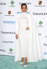 Nicole Richie added major drama to her dress with a flowing white lace cape by Tadashi Shoji.