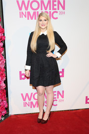 Meghan Trainor added a subtle pop of color via dark red platform pumps.