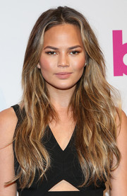 Chrissy Teigen attended the Billboard Women in Music luncheon wearing a sexy wavy hairstyle.