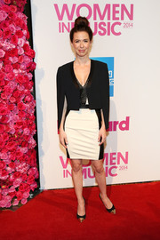 Joy Williams teamed a black cape/blazer with a monochrome mini for the Billboard Women in Music luncheon.