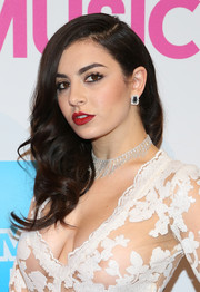 Charli XCX sweetened up her look with a curly side sweep during the Billboard Women in Music luncheon.