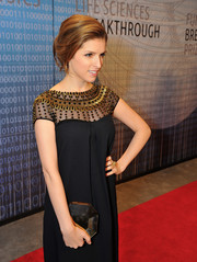 Anna Kendrick's mirrored octagon clutch and embellished gown at the Breakthrough Prizes ceremony were a very elegant pairing.