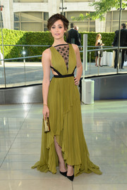 Emmy Rossum looked downright divine in an olive-green J. Mendel gown with a sheer, embellished neckline during the CFDA Fashion Awards.
