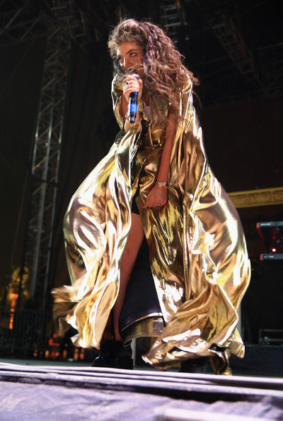 Lorde looked otherworldly in a floaty gold coat while performing at 2014 Coachella.