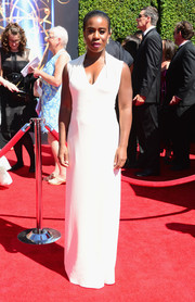 Uzo Aduba was all about minimalist elegance in a sleeveless white column dress by Costume National during the Creative Arts Emmy Awards.