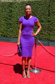 Aisha Tyler chose a cap-sleeve sheath in a vibrant purple hue for her Creative Arts Emmy Awards look.