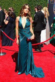 Nikki Reed struck a sultry pose in a teal Versace gown with a deep-V plunge during the Creative Arts Emmy Awards.