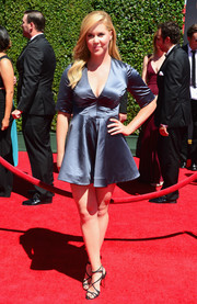 Amy Schumer went for a leggy look with this super-short gray satin dress at the Creative Arts Emmy Awards.