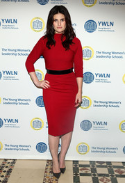 Idina Menzel attended the (Em)Power breakfast wearing a simple yet stylish red sweater dress with a black belt.
