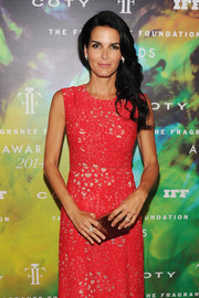 Angie Harmon paired a gold Lee Savage box clutch with an embroidered pink dress for the Fragrance Foundation Awards.