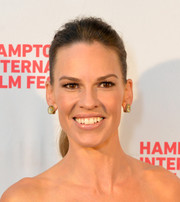 Hilary Swank accessorized with a pair of gold and diamond studs for a chicer finish.