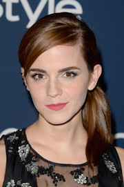 Emma Watson finished off her look with a pretty pink lip.