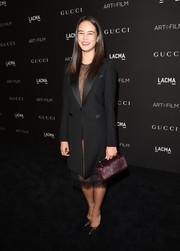 Courtney Eaton topped off her ensemble with a maroon fur purse by M2Malletier.