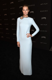 Toni Garrn went for minimalist elegance at the LACMA Art + Film Gala in a long-sleeve pale-blue Gucci column dress featuring a bedazzled neckline.