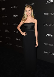 Nicola Peltz kept it simple and classic in a black Gucci strapless gown during the LACMA Art + Film Gala.