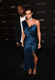 Kim Kardashian completed her glamorous look with silver chain-strap sandals by Tom Ford.