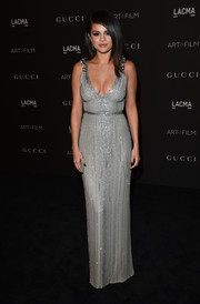 Selena Gomez made an ultra-sophisticated choice with this cleavage-baring, beaded gray column dress by Gucci for the LACMA Art + Film Gala.