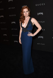 Amy Adams went for sultry elegance at the LACMA Art + Film Gala in a blue Gucci gown with a beaded bodice and a deep-V plunge.