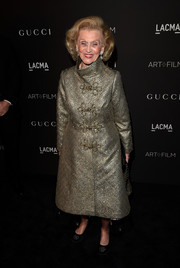 Barbara Davis arrived for the LACMA Art + Film Gala looking very refined in her gold evening coat.