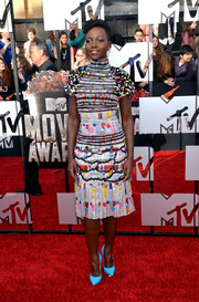Lupita Nyong'o sported a playful mix of colors in a hot-off-the-runway Chanel cocktail dress during the MTV Movie Awards.